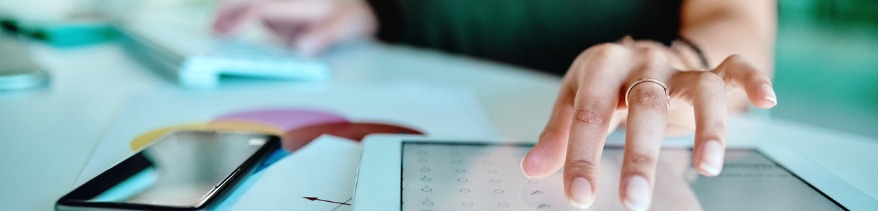 Businesswoman Using a Digital Tablet at Her Desk